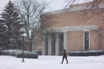 A lone student braces against the winter storm outside of Moore Hall on March 1, 2016.